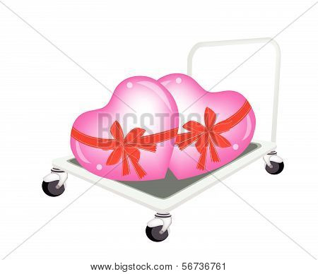 Hand Truck Loading Beautiful Two Red Hearts