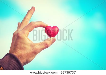 Heart Shape Love Symbol In Man Hand Valentines Day Holiday Romantic Greeting With Blue Sky On Backgr