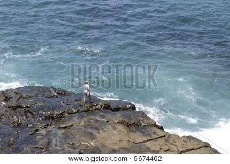 Fisherman On Remore Reef