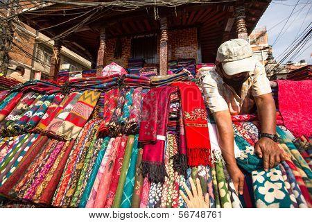 KATHMANDU, NEPAL - NOV 28: Unidentified street seller in historic center of city, Nov 28, 2013 in Kathmandu, Nepal. Largest city of Nepal, its economic center, a population of over 1 million people.