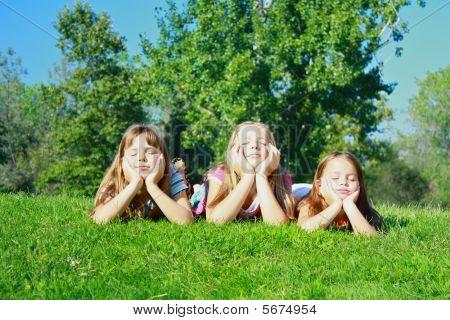 Girls Lying On Grass