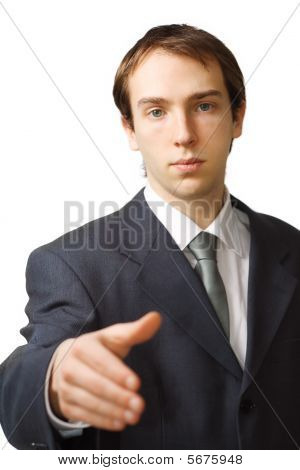 Young Business Man Hand Shake With Focus On Face