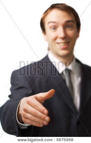 Happy Young Business Man Handshake With Focus On The Hand