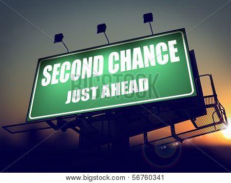 Second Chance Just Ahead on Green Billboard.