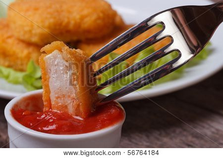 Chicken Nuggets Impaled On A Fork In Ketchup