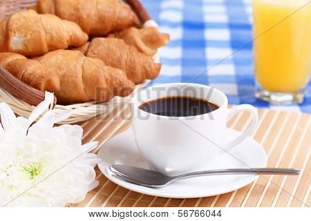 Continental breakfast with croisant and black coffee