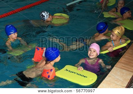 Children 8 Years Old Learn To Swim In Lap Pool.