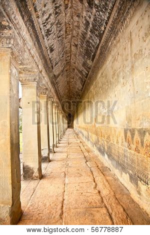 Ancient stone passage of Angkor Wat temple , near Siem Reap, Cambodia.