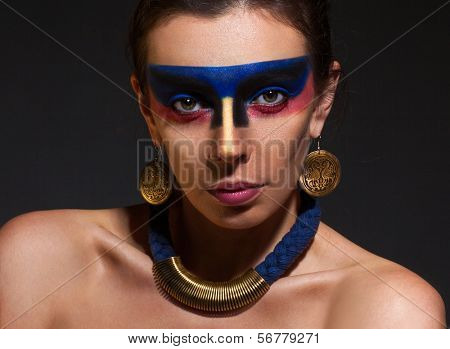 Portrait of woman with art make-up on dark backgroung