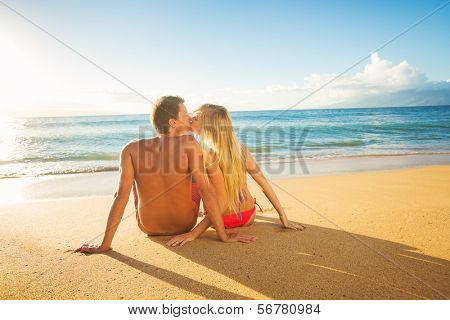 Happy Romantic Couple Kissing Watching the Sunset on Tropical Beach Vacation