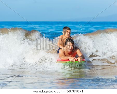 Father and Son Surfing Tandem Together Catching Ocean Wave, Carefree happy fun smiling lifestyle