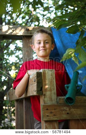 Boy in tree fort
