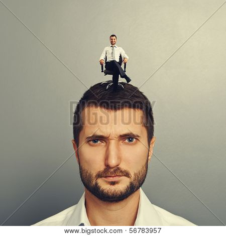 portrait of discontented man with happy man on the head