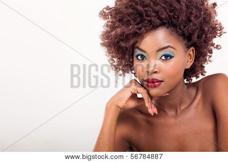 pretty african woman with stylish makeup on plain background