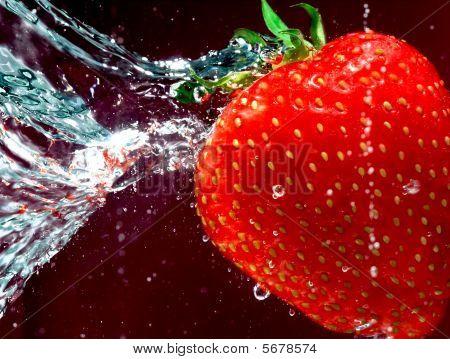 Ripe Strawberry Swimming Through Water