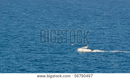 White Motorboat And Blue Sea