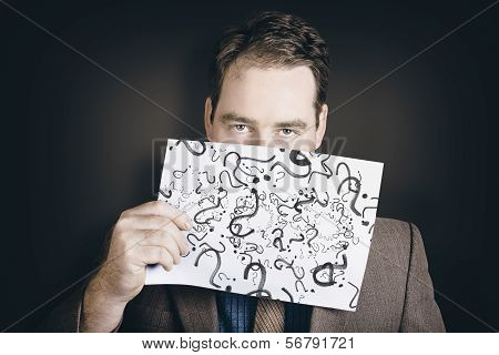 Man With Questions Holding Question Mark Paper