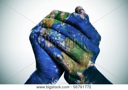 a world map in man hands forming a globe (Earth map furnished by NASA)