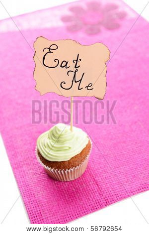 Tasty cupcake with butter cream,on color napkin,  isolated on white