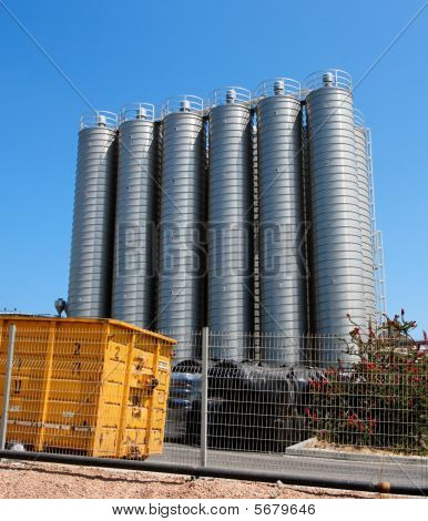 High metal tower silos on chemical plant