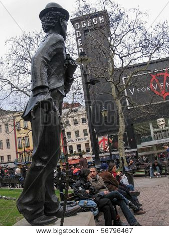 London, Uk - March 30, 2006: Statue Of Charlie Chaplin Against Odeon Movie Theater At Leicester Squa