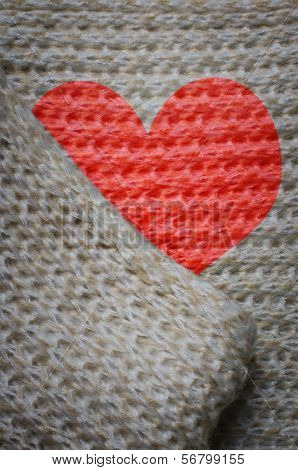 Red Hearth On Woolen Background.