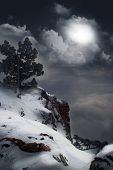 picture of moonlit  - moonlit night and clouds on night sky in the mountains - JPG
