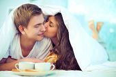 stock photo of bed breakfast  - Couple enjoying one another while having breakfast in bed - JPG