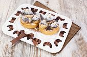 pic of cream puff  - A cream puff filled with scrumptious ice cream covered with rich chocolate - JPG