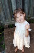 picture of curio  - Cute smiling  curios little girl looking up - JPG