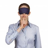 stock photo of blinders  - Pretty young woman blindfolded calls for silence - JPG