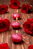 stock photo of unity candle  - Romantic composition with red candles and roses. selective focus