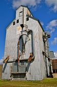 stock photo of chute  - A historic old metal elevator with augers - JPG