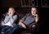 foto of horrific  - Children watching Shocking Television Programming - JPG