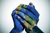 stock photo of union  - a world map in man hands forming a globe  - JPG