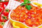 stock photo of pinto bean  - Canned beans with vegetables in tomato sauce