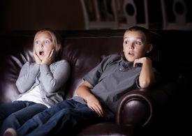 picture of horrific  - Children watching Shocking Television Programming - JPG
