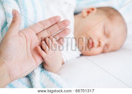 newborn baby one month age on white