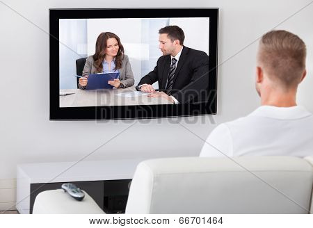 Man Sitting Watching Television At Home