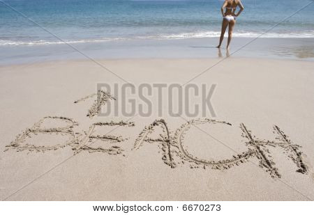 Writing Word In Sand With Shapely Bikini Girl Tropical Beach