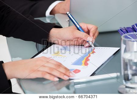 Businesswoman Writing On Graph