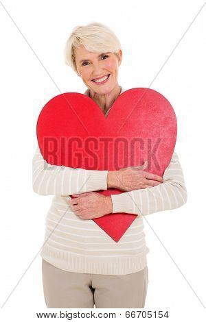 beautiful mid  age woman hugging red heart shape