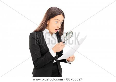 Shocked woman looking at a document with scrutiny isolated on white background