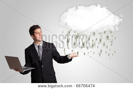 Man with white cloud and money rain concept