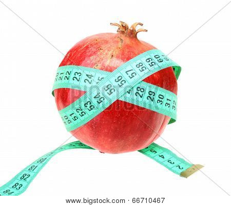 Measure Tape On Red Pomegranate