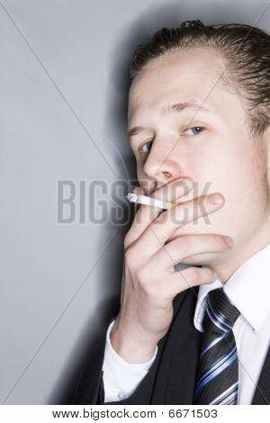 Young smoking man