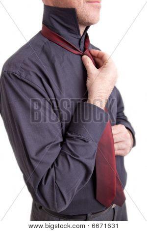 Man Tying A Necktie