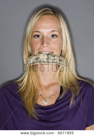 Woman eating money