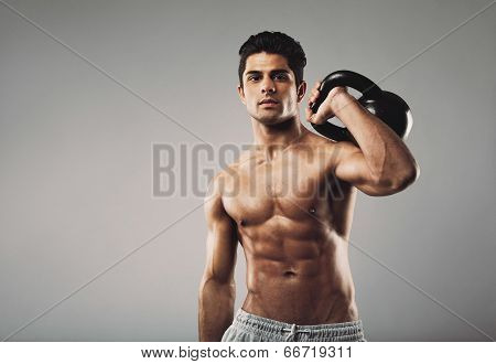Muscular Man Performing Workout With Kettlebell