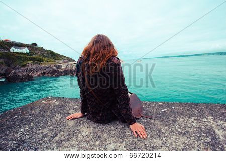 Young Woman By The Water's Edge